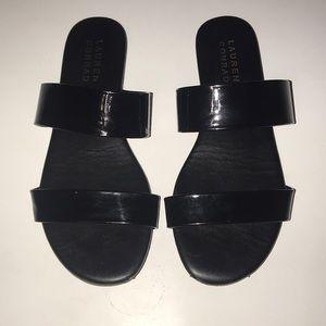 Black flat sandals.